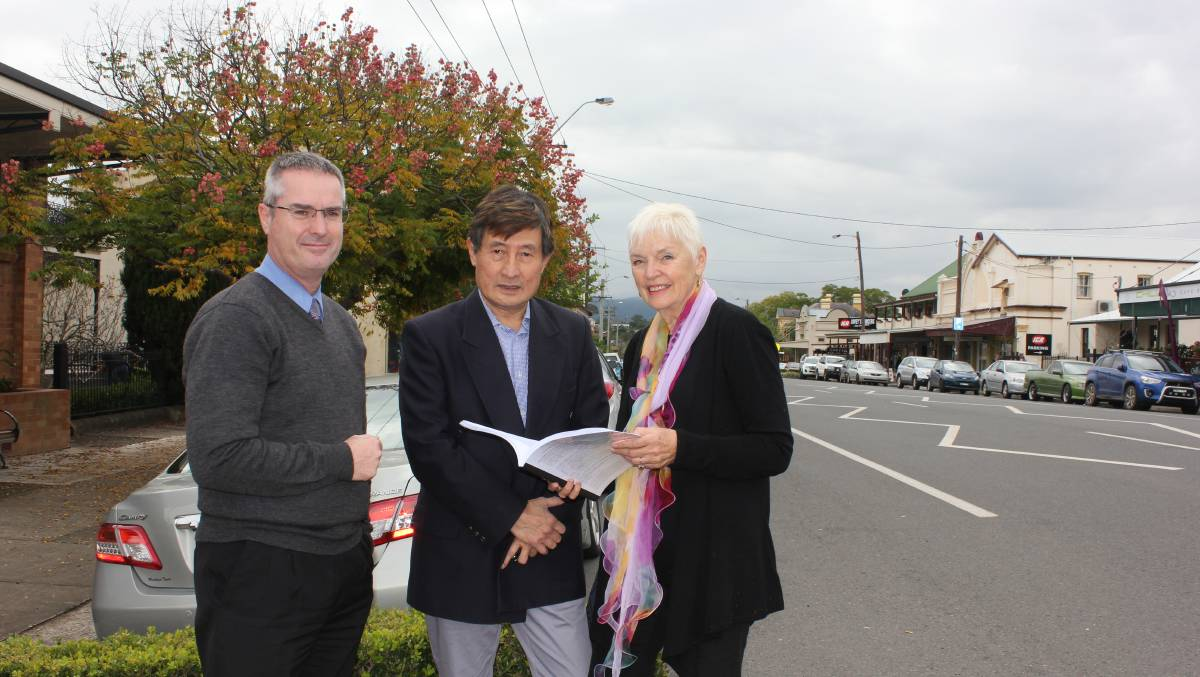 Getting on with the job: Dungog's new mayor Nancy Knudsen with council's acting general manager Shaun Chandler and Kim Chua.